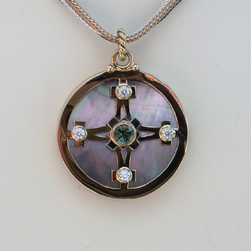 Shield: 18k, diamonds, tourmaline, mother of pearl