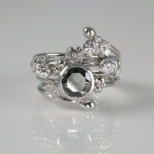 Ring; 18k white gold, black diamond, diamonds twvvs